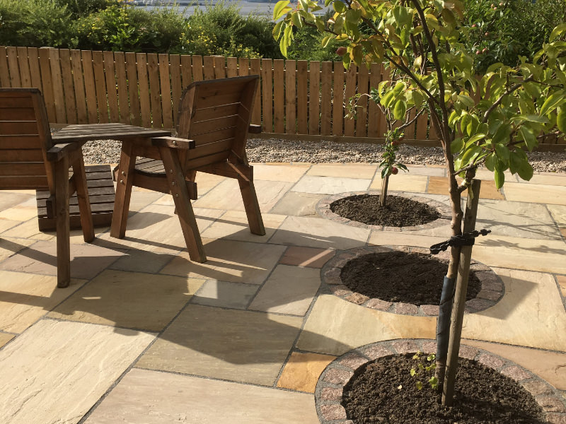 New patio and trees with seats and table in Edinburgh garden design example